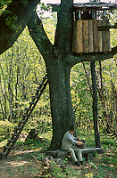 Josko Sirk sitting under the treehouse located 200 metres from his Kozolec inspired house in the woods