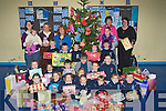 CHRISTMAS GIFTS: Junior infants class from Ardfert NS who put parcels together for the Kerry branch of Adapt on Monday.