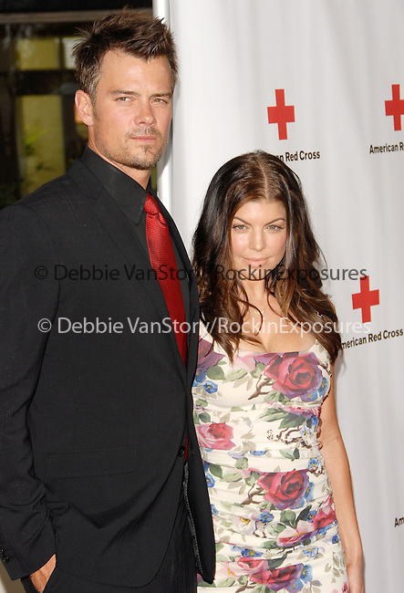 Josh Duhamel & Stacy Ferguson Duhamel aka Fergie at the Annual Red Tie Affair.Honoring Jada Pinkett Smith and the cast of HawthoRNe hosted by The American Red Cross: Santa Monica Chapter held at Fairmont Miramar Hotel in Santa Monica, California on April 17,2010                                                                   Copyright 2010  DVS / RockinExposures