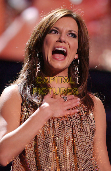 MARTINA McBRIDE.2007 CMA Music Festival held at LP Field,Nashville, Tennessee, USA, 09  June 2007..portrait headshot hand on  chest mouth open funny country.CAP/ADM/LF.©Laura Farr/AdMedia/Capital Pictures.