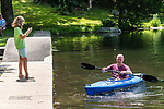 BEACON FALLS, CT. 13 July 2019-071319 - Rebecca Armstrong, 10, of Beacon Falls, left, takes a photo of her father Greg Armstrong, as he paddles in a kayak, during family day at Matthies Park in Beacon Falls on Saturday. Bill Shettle Republican-American