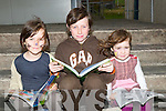 READING: Bey Guilfoyle, Cillian O'Regan  and hazel Guilfoyle, getting into the reading while the entertaqining was going on at the 10th Anniversary of Mercy Mounthawk Secondary School on Sunday.............