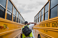 Johnny Crudup (CQ), a full-time substitute bus driver for Wake County at Southeastern Raleigh Magnet High school in Raleigh, NC on Friday, March 31, 2017. (Justin Cook for The Wall Street Journal)<br /> <br /> BUSES Summary<br /> A shortage of school bus drivers is forcing one of North Carolina&rsquo;s largest school districts to consider starting class as early as 7:10 a.m. and as late as 9:15 a.m. this fall, to give the limited number of drivers time to do three or more runs each morning.