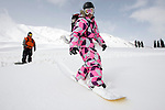 A snowboarder takes off from the phase one Kongdori mid station of the northern hemisphere's highest gondola at the ski fields at Gulmarg in the disputed northern Indian state of Kashmir. 60 kilometres's from Srinagar tourists are drawn from all over the world for the cheap skiing and Indian experience.