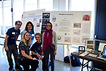 Jesus Sanchez, Marcus Pavalonis, Regan Falin, Citlali Elena and Nouran Alhazmi pose next to their poster on how their art is influced by life and decay. They had the opportunity to see a human cadaver and create art influenced by the experience.