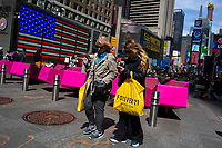 NEW YORK, NY - APRIL 2: Women carry their shopping  plastic bag as they walk along Times Square on April 2, 2019 in New York. New York will become the second state in U.S. to ban shops from providing single-use plastic bags for most purchases.   (Photo by Eduardo MunozAlvarez/VIEWpress)