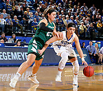 SIOUX FALLS, SD - NOVEMBER 29: Rylie Cascio Jensen #2 from South Dakota State controls the dribble against Lyndsey Robson #25 from Wisconsin Green Bay during their game Thursday night at Frost Arena in Brookings. (Photo by Dave Eggen/Inertia)