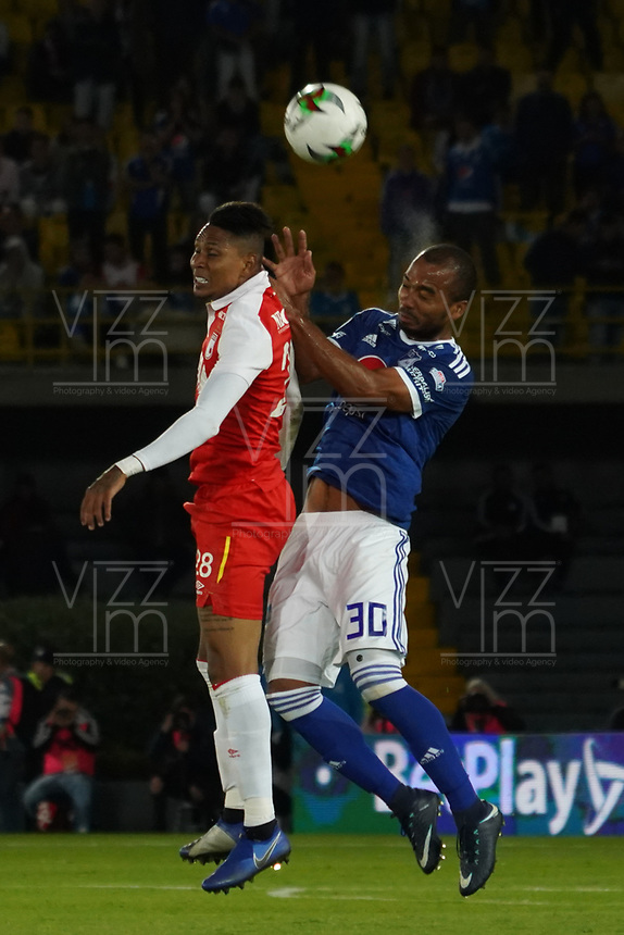BOGOTA - COLOMBIA, 15-01-2019: Arley Rodriguez (Izq) Jugador del Independiente Santa Fe, disputa balon con Luis Payares (Der) jugador de Millonarios, durante partido entre Independiente Santa Fe y Millonarios, por el Torneo Fox Sports 2019, jugado en el estadio Nemesio Camacho El Campin de la ciudad de Bogota. / Arley Rodriguez (L) player of Independiente Santa Fe vies for the ball with Luis Payares (R) Player of Millonarios during a match between Independiente Santa Fe and Millonarios, for the Fox Sports Tournament 2019, played at the Nemesio Camacho El Campin stadium in the city of Bogota. Photo: VizzorImage / Diego Cuevas / Cont.