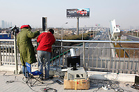 Technicians install traffic cameras in Shanghai, China..13 Jan 2009