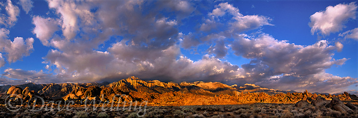 902000007 panoramic view of sunrise lighting up clearing storm clouds and the eastern sierras mountain range from the alabama hills blm protected lands in kern county california