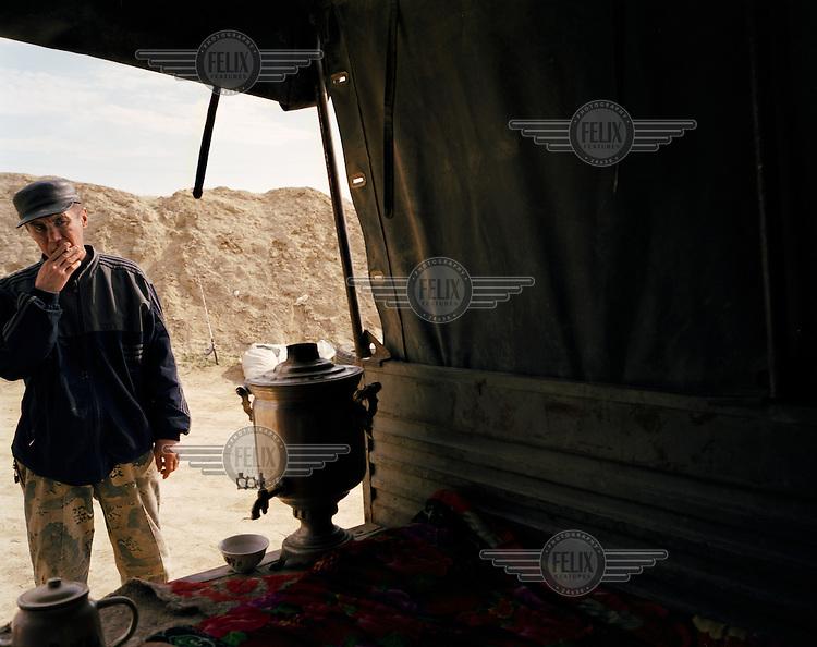 An Aral Sea fisherman returns to his truck for a tea break.