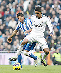 Real Madrid's Raphael Varane (r) and Real Sociedad's Diego Ifran during La Liga match.January 06,2013. (ALTERPHOTOS/Acero)