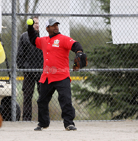 TORONTO, CANADA - MAY 15:  Even in the rain Actor Kurt Russell teams up with actor Alfonso Ribeiro, of Fresh Prince of Bel-air fame and some of MLB alumni, athletes and celebrities for Strike Out Cancer Celebrity Baseball Tournament, benefiting breast and ovarian cancer education and research at Mount Sinai Hospital. on May 15, 2011 in Toronto, Canada.   <br />