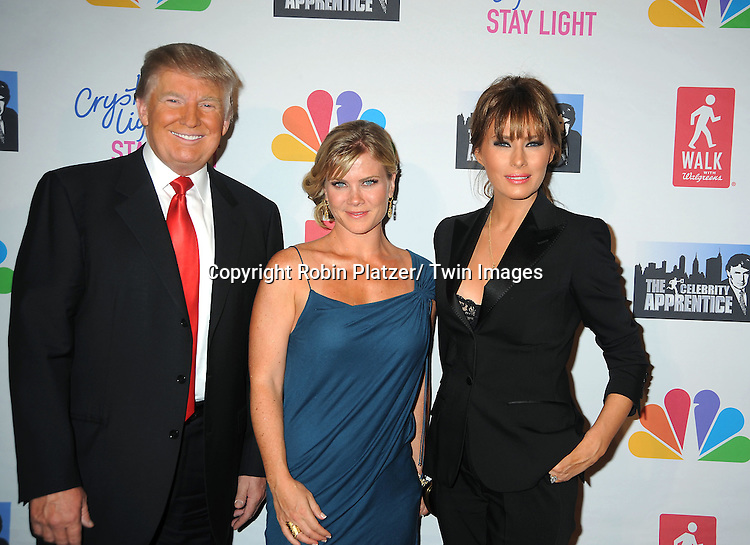 Donald Trump and wife Melania Trump with Alison Sweeney attend The Celebrity Apprentice Live Finale at The Museum of Natural History in New York City on May 20, 2012.