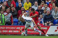 Mitch Duggan of Tranmere Rovers catches Danny Ings of Liverpool in the face to cause a nasty cut during the 2016/17 Pre Season Friendly match between Tranmere Rovers and Liverpool at Prenton Park, Birkenhead, England on 8 July 2016. Photo by PRiME Media Images.