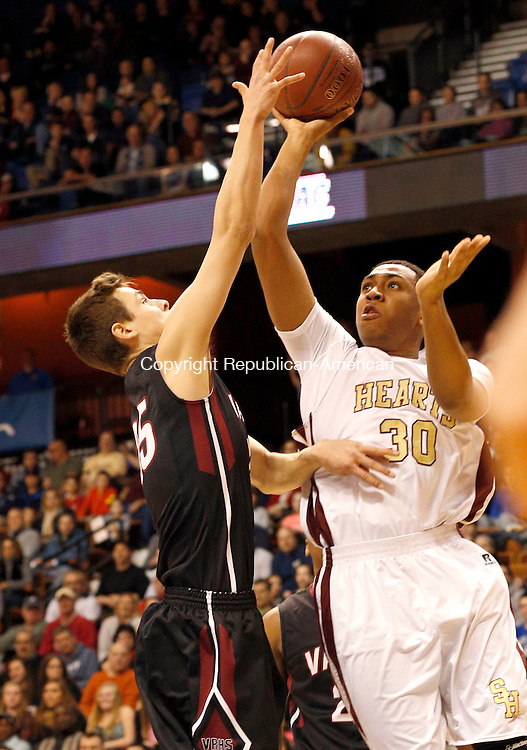 Uncasville, CT- 22 March 2015-032215CM20- Sacred Heart's Isaiah Rascoe goes for two against Valley Regional's Christopher Jean-Pierre during the Class S state championship game at Mohegan Sun Arena in Uncasville on Sunday.  The Hearts won, 71-46.   Christopher Massa Republican-American
