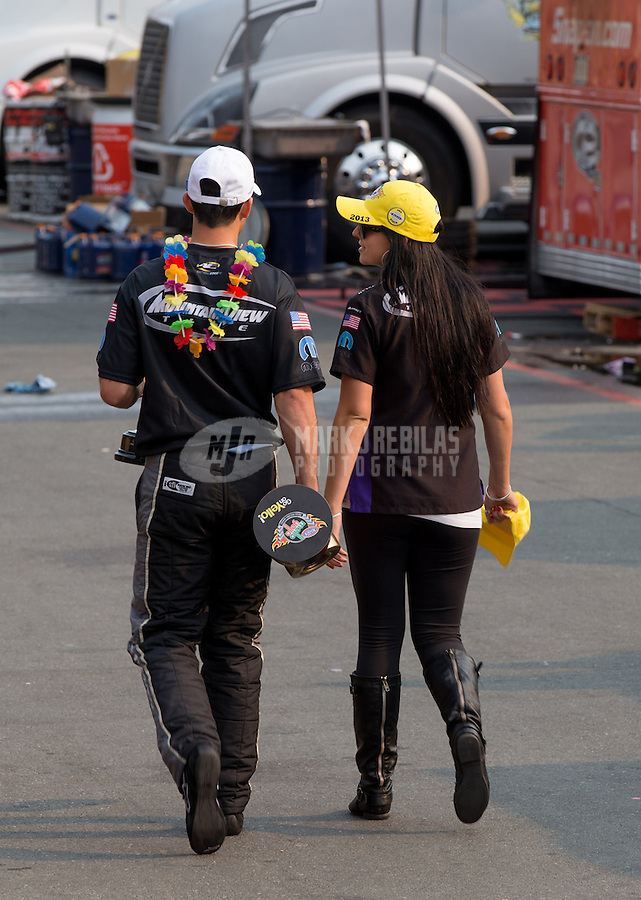 Jul. 28, 2013; Sonoma, CA, USA: NHRA pro stock driver Vincent Nobile after winning walking away with his girlfriend the Sonoma Nationals at Sonoma Raceway. Mandatory Credit: Mark J. Rebilas-