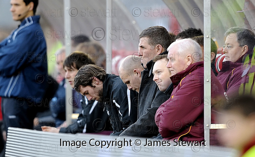 20/12/2008  Copyright Pic: James Stewart.File Name : sct_jspa29_hamilton_v_motherwell.MOTHERWELL MANAGER MARK MCGHEE WATCHES FROM THE DUG OUT.James Stewart Photo Agency 19 Carronlea Drive, Falkirk. FK2 8DN      Vat Reg No. 607 6932 25.Studio      : +44 (0)1324 611191 .Mobile      : +44 (0)7721 416997.E-mail  :  jim@jspa.co.uk.If you require further information then contact Jim Stewart on any of the numbers above.........