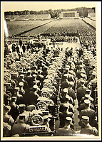 BNPS.co.uk (01202 558833)<br /> Pic: ChalkwellAuctions/BNPS<br /> <br /> Nuremberg Rally - A chilling illustration of the Nazi PR machine.<br /> <br /> Found in a cardboard box...a meticulous account ofthe pre war rise of the cult of Hitler.<br /> <br /> An incredible picture archive that charts the rise of Hitler believed to have been meticulously documented by a fan of the Fuhrer has emerged for sale.<br /> <br /> The collection of propaganda photographs show Adolf Hitler on a charm offensive in the 1920s and 30s - before the evil dictator started the Second World War and eliminated at least five million Jews in the Holocaust.<br /> <br /> Some of the images try to show a softer side to the Nazi leader, with him feeding a small deer and accepting a bouquet from a young girl.<br /> <br /> Others chillingly show the hype created around him - rows of people performing the straight-arm Nazi salute, a young boy beaming as Hitler signs an autograph for him and a group of girls giggling as they chat to the party leader.