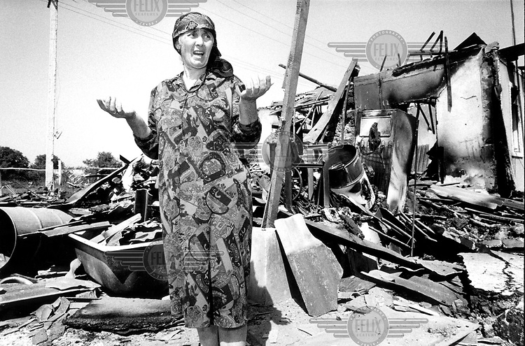 """©Martin Adler/Panos Pictures..Chechnya, Grozny. Zubidat Isailana (56) amidst the ruins of her home destroyed by russian artillery fire the day before. """"Why are they doing this to us?"""" She asks."""