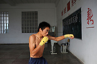 Li Le Fa, 15, shadow boxes in Huili Middle School in Sichuan Province, China. The group of young boxers are hoping to make it to become some of China's first professional boxers...PHOTO BY SINOPIX
