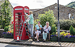 Scarecrow Festival at Kettlewell in Yorkshire 2013<br /> <br /> Sterling job from this chap painting the telephone box.<br /> <br /> Scarecrows are made by local community and places in and around their front gardens.  Competition is fierce but it's all to raise money  for the local church  and other local projects to benefit the whole community.<br /> <br /> <br /> <br /> Picture by Gavin Rodgers/ Pixel 8000 <br /> <br /> 07917221968