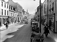 High Street, Killarney in 1955.<br /> Picture by Harry MacMonagle.