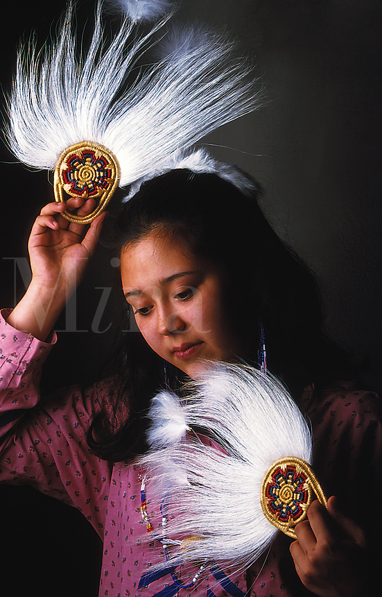 Portrait of a Yupik woman posing with traditional fans. Alaska.