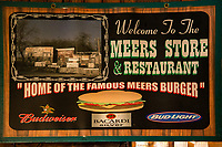 """Once a bustling town of miners seeking gold in the Wichita Mountains, all that remains of the town of Meers now is our world renowned family restaurant of the same name. Meers population has dwindled from the gold rush peak of 500 down to the present residents: one family of six people, eight cats and a dog. The Meers Store and Restaurant has became famous for our Meersburger, a 7"""" diameter burger made exclusively from prize winning Texas Longhorn beef raised on the family's own ranch. Beef that is actually lower in cholesterol than chicken!"""