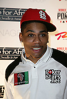 NELLY (Cornell Haynes, Jr.).The Ante Up for Africa Celebrity Poker Tournament at the Rio Resort Hotel and Casino, Las Vegas, Nevada, USA..July 2nd, 2009.headshot portrait black white top red baseball cap hat .CAP/ADM/MJT.© MJT/AdMedia/Capital Pictures