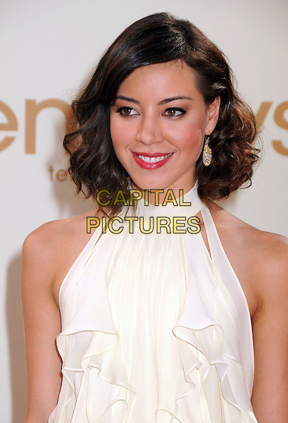 Aubrey Plaza.63rd Primetime Emmy Awards held at Nokia Theatre L.A. Live. Los Angeles, California, USA. .18th September 2011.emmys half length dress white sleeveless headshot portrait.CAP/ADM/BP.©Byron Purvis/AdMedia/Capital Pictures.