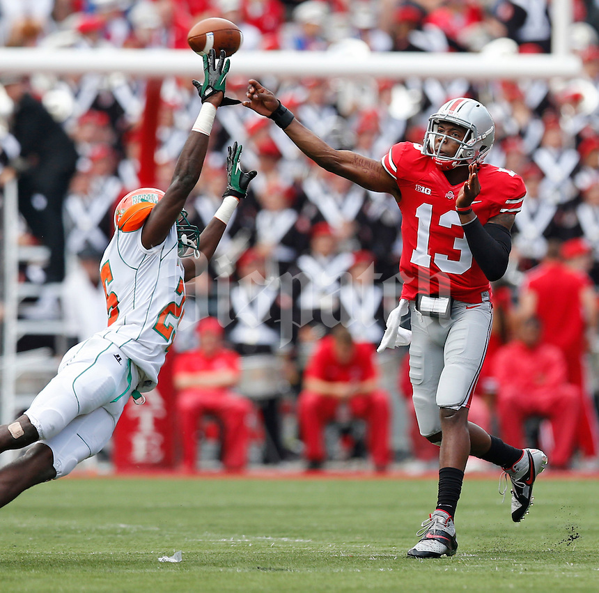 ***Ohio State Buckeyes quarterback Kenny Guiton (13) competes  pass over the finger tips of Florida A&M Rattlers safety John Ojo (25) in first half action at Ohio Stadium on Saturday September 21, 2013.  (Chris Russell/Dispatch Photo)