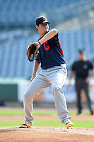 Cody Morris (25) of Reservoir High School in Laurel, Maryland playing for the Cleveland Indians scout team during the East Coast Pro Showcase on August 1, 2014 at NBT Bank Stadium in Syracuse, New York.  (Mike Janes/Four Seam Images)