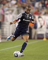New England Revolution defender Darrius Barnes (25) passes the ball. In a Major League Soccer (MLS) match, the Los Angeles Galaxy defeated the New England Revolution, 1-0, at Gillette Stadium on May 28, 2011.