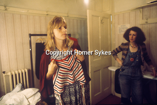 "Linda McCartney Wing Tour 1973. Wardrobe designer Linda chooseing clothes to wear. 1970s UK The photographs from this set were taken in 1975. I was on tour with them for a children's ""Fact Book"". This book was called, The Facts about a Pop Group Featuring Wings. Introduced by Paul McCartney, published by G.Whizzard. They had recently recorded albums, Wildlife, Red Rose Speedway, Band on the Run and Venus and Mars. I believe it was the English leg of Wings Over the World tour. But as I recall they were promoting,  Band on the Run and Venus and Mars in particular."