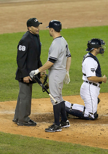 October 04, 2011:  New York Yankees left fielder Brett Gardner (#11) disagrees with strike call by home plate umpire Dan Iassogna during MLB American League Division Series game action between the New York Yankees and the Detroit Tigers at Comerica Park in Detroit, Michigan.  The Yankees defeated the Tigers 10-1.