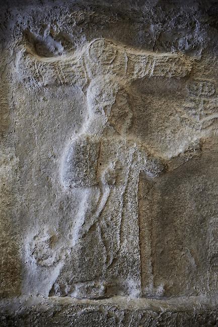 End relief panel of the 13th century BC Hittite religious rock carvings of Yazılıkaya Hittite rock sanctuary, chamber A,  Hattusa, Bogazale, Turkey. Plastercast at the Vorderasiatisches Museum, Pergamon Museum, Berlin.
