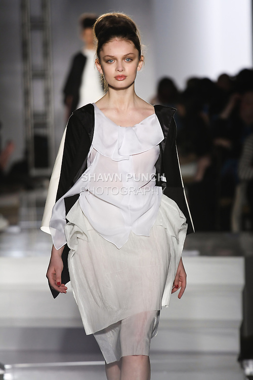Model walks runway in an outfit by Hugo Ka Wai Tsang, for the Parsons 2011 BFA Fashion Show, hosted by Reed Krakoff.