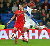 Fidel Escobar of Panama (R) kicks the ball to a corner while closely challenged by Chris Gunter of Wales (L) during the international friendly soccer match between Wales and Panama at Cardiff City Stadium, Cardiff, Wales, UK. Tuesday 14 November 2017.