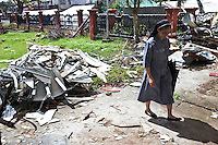 Walking through the damages of the cathedrale in Palo. <br /> <br /> Marcher &agrave; travers les d&eacute;bris de la cath&eacute;drale &agrave; Palo.