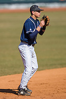 Shortstop Corey Parker #4 of the Catawba Indians on defense versus the Shippensburg Red Raiders February 14, 2010 in Salisbury, North Carolina.  Photo by Brian Westerholt / Four Seam Images
