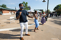 Brandon Claybrook (from left) of Rogers, wife Karrié Claybrook and Emma Willis dance Friday, June 19, 2020, during a Juneteenth cookout at Lawrence Plaza in Bentonville. Go to nwaonline.com/200620Daily/ to see more photos.<br /> (NWA Democrat-Gazette/Ben Goff)