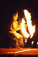 Man performing a Polynesian fire dance, the entertainment at a luau, Sheraton Royal Hawaiian Hotel, Waikiki, Oahu