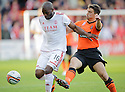 Aberdeen's Isaac Osbourne is challenged by United's Mark Millar  ...