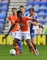 Blackpool's Armand Gnanduillet battles with  Wigan Athletic's Alex Gilbey<br /> <br /> Photographer Dave Howarth/CameraSport<br /> <br /> The Carabao Cup - Wigan Athletic v Blackpool - Tuesday 8th August 2017 - DW Stadium - Wigan<br />  <br /> World Copyright &copy; 2017 CameraSport. All rights reserved. 43 Linden Ave. Countesthorpe. Leicester. England. LE8 5PG - Tel: +44 (0) 116 277 4147 - admin@camerasport.com - www.camerasport.com