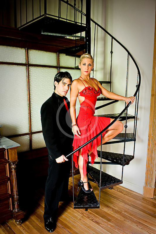 Argentina, Buenos Aires, Tango dancers standing on spiral staircase