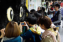 Passersby take pictures of a big cat face on display in Shibuya station on April 5, 2015, Tokyo, Japan. The Japanese courier service Yamato Transport Co., LTD. is using this innovative display to promote its two new services for small packages from April 1st. (Photo by Rodrigo Reyes Marin/AFLO)