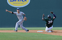 Infielder Taylor Featherston (2) of the Asheville Tourists directs the throw to third base as Leonel Escobar (38) of the Greenville Drive slides safely into second base in a game on Sunday, August 26, 2012, at Fluor Field at the West End in Greenville, South Carolina. Greenville won, 5-4. (Tom Priddy/Four Seam Images)