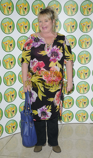Nicola Duffett.attended the Burgess Wetnose Awards, Jumeirah Carlton Tower Hotel, Knightsbridge, London, England, UK, 9th March 2012..full length black floral print dress over trousers blue bag .CAP/CAN.©Can Nguyen/Capital Pictures.