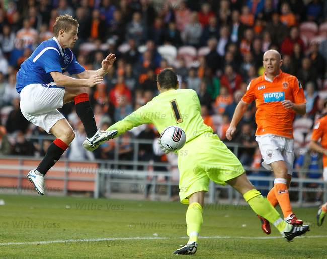 Steven Davis scores the opening goal for Rangers past keeper Matt Gilks